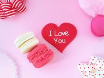 Delicious macaroon, red heart, pink background Royalty Free Stock Photography