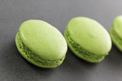 Delicious macaroons. Three delicious green macaroons in kitchen Royalty Free Stock Photo