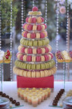 Delicious macaroons on candy bar Stock Photo