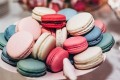 Delicious macaroons close-up. candy bar at luxury wedding reception. exclusive expensive catering. table with modern desserts. sp. Ace for text. baby or bridal stock image