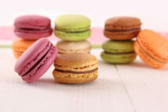 Delicious macaroons on wood table Royalty Free Stock Images