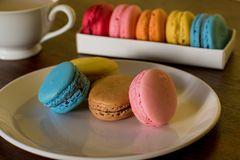Delicious macaroons on the wooden table, with copy space stock photos
