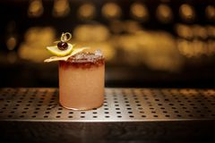 Delicious Mai Tai cocktail with dried pineapple, lime slice and royalty free stock photo