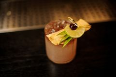 Delicious Mai Tai cocktail with dried pineapple, lime slice and stock image
