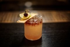 Delicious Mai Tai cocktail with dried pineapple, lime slice and red berry stock images