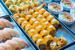 Delicious Maki roll in the roll on metal plate. For buffet Royalty Free Stock Photo