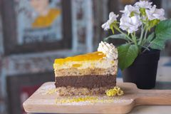 Delicious mango cake on wood stock photography