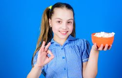 Delicious marshmallow. Candy shop. Small girl eat delicious marshmallow. Healthy food and dental care. happy little royalty free stock photos