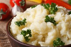 Delicious mashed potatoes in a bowl macro horizontal. rustic sty Royalty Free Stock Image