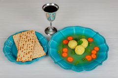 Delicious Matzoh ball soup with Pesach Passover symbols. Delicious Matzoh ball soup with matzah, Jewish symbols for the Passover Pesach holiday Royalty Free Stock Images