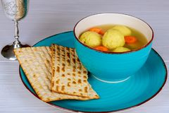 Delicious Matzoh ball soup with Pesach Passover symbols. Delicious Matzoh ball soup with matzah, Jewish symbols for the Passover Pesach holiday Royalty Free Stock Photos