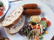 Bread and croquette. A delicious meal, perfectly for lunch, and dinner. Bread with croquette stock image
