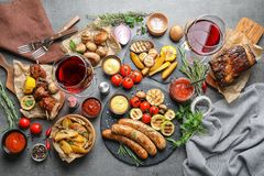 Delicious meal served for barbecue party on gray table. Flat lay stock images