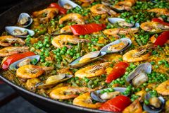 Delicious meal with shrimp , Mussel and spices pepper seafood in huge frying pan for sale at weekend street food market bangkok royalty free stock photography