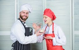 Delicious meal. Woman and bearded man cooking together. Couple compete in culinary. Try ingredients before cook stock images