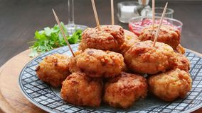 Delicious meat balls on plate over wooden table royalty free stock photo