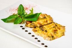 Delicious meat casserole with egg and herbs. Horizontal frame Royalty Free Stock Photography