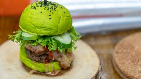 Delicious Meat Green Burger With Fresh Vegetable stock photo