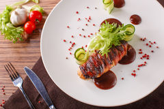 Delicious meat loaf with ketchup on a white plate, macro horizontal Stock Image