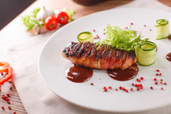 Delicious meat loaf with ketchup on a white plate, macro horizontal Royalty Free Stock Photography