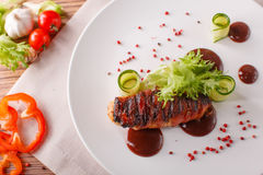 Delicious meat loaf with ketchup on a white plate, macro horizontal Royalty Free Stock Image