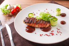 Delicious meat loaf with ketchup on a white plate, macro horizontal Stock Photography