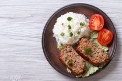 Delicious meat loaf with rice on a plate, horizontal top view Royalty Free Stock Photos