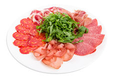 Delicious meat platter with arugula. Stock Photos