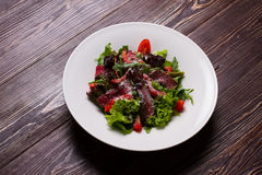 Delicious meat salad. Spring salad on a beautiful platter stock images