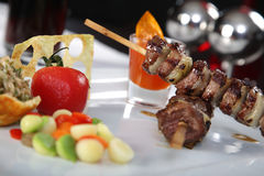 Delicious Meat Skewers. With on a dish with vegetables Royalty Free Stock Images
