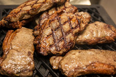 Delicious meat steak  are fried on grilled. close-up. Delicious meat steak  are fried on grilled. BBQ party . close-up Royalty Free Stock Photos