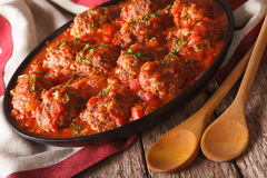 Delicious Meatballs albondigas with spicy sauce on a plate close Stock Photos