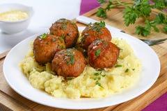 Delicious meatballs on hot potato puree Stock Photos