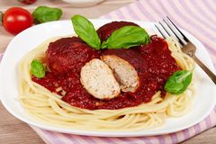 Meatballs with tomato sauce and spaghetti pasta Stock Images