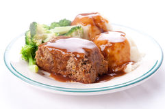 Delicious meatloaf with mashed potatoes, gravy and fresh vegetab Stock Photos