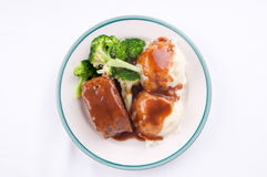 Delicious meatloaf with mashed potatoes, gravy and fresh vegetab Royalty Free Stock Photos