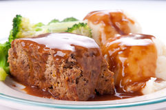 Delicious meatloaf with mashed potatoes, gravy and fresh vegetab Royalty Free Stock Photo