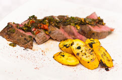 Delicious medallions of tenderloin steak placed Royalty Free Stock Image