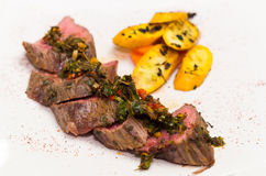 Delicious medallions of tenderloin steak placed Royalty Free Stock Photography