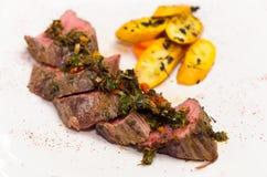 Delicious medallions of tenderloin steak placed Stock Image