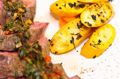 Delicious medallions of tenderloin steak placed Stock Photos