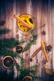 Delicious medicinal tea lemon orange cinnamon cloves winter even Royalty Free Stock Photos