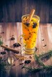 Delicious medicinal tea lemon orange cinnamon cloves winter even Stock Photo