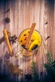 Delicious medicinal tea lemon orange cinnamon cloves winter even Stock Photos