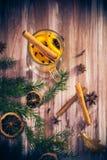 Delicious medicinal tea lemon orange cinnamon cloves winter even Stock Images