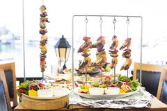 Mediterranean style fresh fish and prawn skewers shish stock images