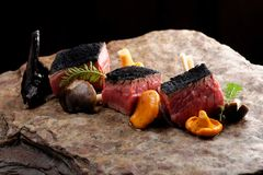 Delicious medium beef steaks with mushrooms Stock Photo
