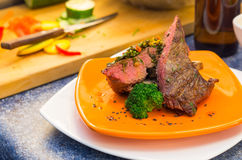 Delicious medium rare sirloin steaks and Stock Images