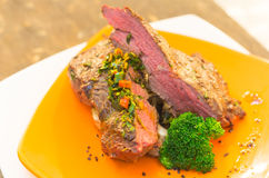 Delicious medium rare sirloin steaks and Royalty Free Stock Images