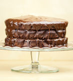 Delicious melted chocolate cake. On brown background Stock Image